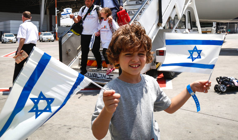 small boy with Israeli flags