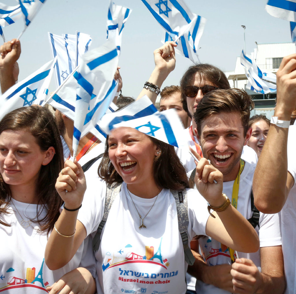 Young people waving small flags of Isreal